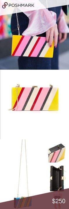 Milly Stripe Box Clutch💖 NWT Authentic Milly clutch. Sold out in stores. Multicolored stripes with glitter accent details. Hardshell. Polished buckle clasp opens the top. Lined, 1 pocket interior, optional snake-chain strap. Original dust bag and care card included. One side is the pink color combo, other side is the blue. Measurements: 3.75in H x 7.75in L x 1.5in Depth. Strap drop 23.5in                       •n o  t r a d e s• •s m o k e  f r e e / p e t  f r e e  h o m e•   •s a m e / n…