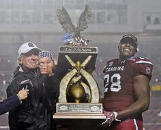 Steve Spurrier and Jonathan Walton : Must-see thrilling 2014-15 college football bowl photos