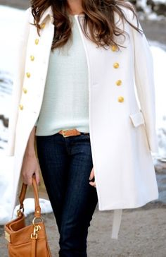 dark jeans and a winter white coat