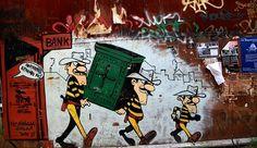 Γκράφιτι με θέμα την οικονομική κρίση στα Εξάρχεια με τον Λουκι Λουκ και τους Ντάλτον. Φεβρουάριος 2017.