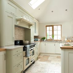 Our Classic Deluxe cooker in cream complements this beautiful kitchen perfectly!