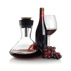 Aerato // Red Wine Carafe. Aerato brings red wine tasting and drinking to a higher level of enjoyment. With this easy but complete wine carafe you have everything you need to air wine, serve wine and poor wine. The carafe set includes a bamboo lid.