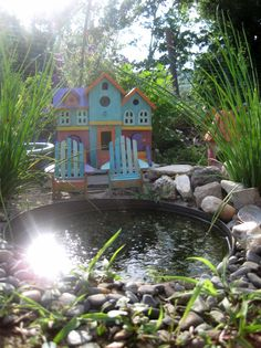 Mini Garden- The house is a bird house just painted! Use a plastic container with no drainage on the bottom as a mini pond.