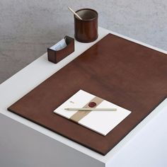 An instant solution to achieve a tidy desk. This gift set contains some of our popular desk accessories: business card holder, round pen pot and large desk mat. Business Card Holder x x Round Pen Pot x Leather Business Card Holder, Business Card Holders, Desk Accessories, Decorative Accessories, Desk Protector, Blind Embossing, Round Pen, Large Desk, Desk Mat