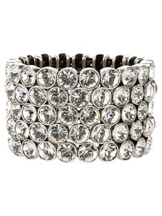 Silver-tone metallic cuff from Philippe Audibert featuring a five row clear crystal design with a silver-tone metallic surround, a silver-tone design logo coin charm and an elasticated fit.