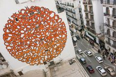 "eL Seed creates a mural for DJART on the streets of Algiers in Algeria '14 ~ The Tunisian calligraphy artist went big with this beautiful piece which is based on the song ""Bilad Al Khayr"" from Dahman El Harrachi. In case you read arabic, here are the lyrics:  كيفاش ننسى بلاد الخير كيفاش يصبر قلبي تهنى كيفاش صغري جايز فقير ووطني غالي مايفنى"