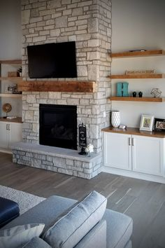 Fireplace stone surround in modern farmhouse & rustic craftsman styles for exterior stone veneer architecture design w/ blue shakes & stone fireplace surround w/ wood mantel & stone hearth. Fireplace Built Ins, Home Fireplace, Fireplace Remodel, Living Room With Fireplace, Fireplace Design, Craftsman Fireplace Mantels, Mantle, Stone Veneer Fireplace, Stone Fireplace Surround