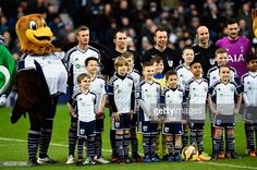 Harry Beckham right with the mascot pictured with his teammates in West Bromwich Albion F.C.