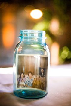 reception centerpiece ideas. could be to cool to include pics of us.  maybe near guestbook? or on tables + some jars w/ flowers?