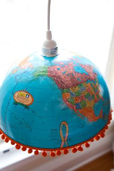 cute recycled world globe lamp with the pom poms