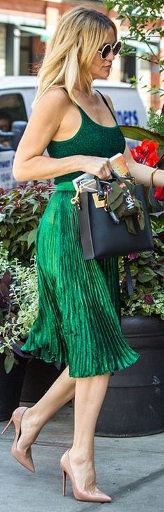 Who made Kate Hudson's nude pumps, green pleated skirt, tank top, and black tote handbag?