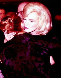 """Marilyn kisses Paula Strasberg at a benefit for The Actors Studio in March 1961. """
