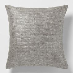 Metallic Brush Pillow Cover – Silver #westelm for the brown couch.  Acts as a grey pillow but b/c it's metallic, it adds a touch of understated glamour.