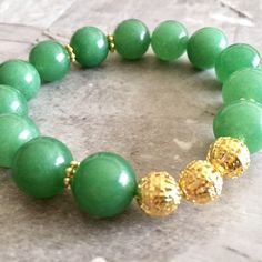 Excited to share the latest addition to my #etsy shop: Green Glass & Gold Stretch Bracelet