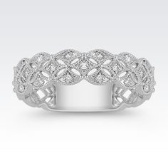 This 14 karat white gold ring has a unique woven design.  The ring features 19 sparkling round diamonds, at approximately .12 carat total weight.  Each stone has been hand-selected to display consistent fire and brilliance in the 5mm wide ring.