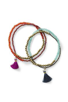 Inspire others to action by wearing the handcrafted Fossil x Me to We three-piece beaded bracelet.