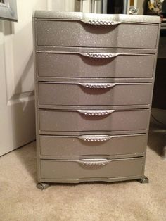 Plastic 6 drawer bin from Walmart... Spray paint , glitter and crystal stickers!!! Great for makeup storage... Best part, they can be stacked to make a tower.