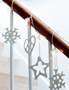 Think about hanging white Scandi inspired Christmas decorations from your banister for something a little different.