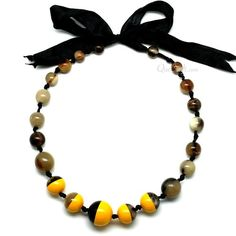"A beautiful beaded necklace handmade from buffalo horn and yellow lacquer. High polish finish. Lightweight. Actual colors may vary. 17.72"" (45cm) length."