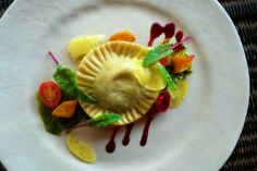Butternut and Goats cheese Ravioli with Basil pesto, baby spinach and Port reduction How To Dry Sage, Cheese Ravioli, Dough Ingredients, Basil Pesto, Roasted Butternut, Baby Spinach, Oven Roast, Edible Flowers, Goat Cheese