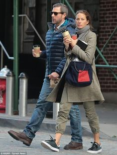 Cup of Joe to go: Christy Turlington and husband Ed Norton grabbed hot coffees as they wal...