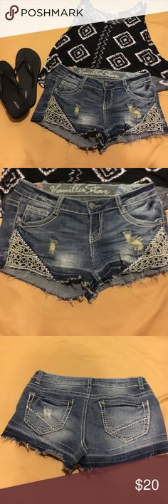 Denim shorts with lace / crochet pocket In like new condition distressed denim shorts with crochet detail . Vanilla Star Shorts Jean Shorts