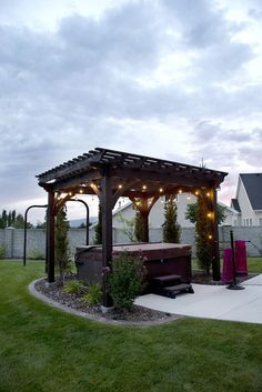Heavenly Haven DIY pergola over hot tub with a timber frame trellis for hanging a hammock.