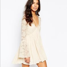 NWT Free People lace mesh dress (cream) NWT cream dress, lace top and sleeves, comes with a slip with adjustable straps. Perfect condition, no missing buttons/stains/tear. Retails for $128 + tax. Looking to sell or trade for a Free People Reign Over Me Lace Dress in white XS (see last picture). Free People Dresses Mini