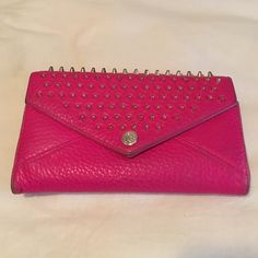 Rebecca Minkoff studded hot pink wallet Slightly worn Rebecca Minkoff wallet. Hot pink with studs adds so much fun to an outfit <3 Rebecca Minkoff Bags Wallets