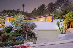 The Los Angeles home has a distinctive butterfly roof that became popular in California during the 1950s-1960s. Image via Flickr user MidCentArc
