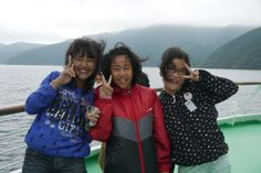 A photo I took of some young girls on the deck of our scenic boat ride on Lake Ashi in Japan.