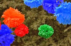 12 Tissue Pom Poms- Sesame Street party. $48.00, via Etsy.