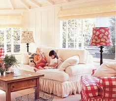 Cottage living room with red gingham and white fabric slipcovered couches, a wood coffee table, and floor lamps. I love the architecture of the room! Red Decor, Decor, Red Cottage, French Country Living Room, Family Room, Family Living Rooms, Cozy House, Cottage Decor, Home Decor