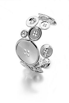 Huge silver bangle, hinged, made of buttons!! OMG swooon. I love this, at £425.00...... it's a present to me!