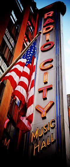 Radio City Music Hall in New York City.  Everybody should see the Rockettes dance at least once in their lives!  I've actually been on the stage during a tour!  Awesome!