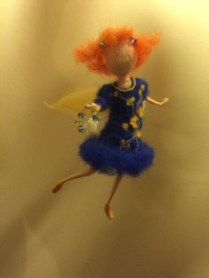 Magic Fairy is tender and floating, holding in his hand a necklace. Emphasis is curly red hair and bright blue dress with yellow flowers.