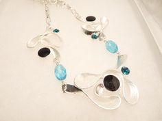Handmade necklace w enamel swirls & crystals