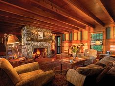 Built from stones found on the property, the large fieldstone fireplace dominates one end of the comfortable living room. Oriental rugs and simple upholstered furniture suit the relaxed mood. Summer Cabins, Burlington House, Cabin Fireplace, Cost Of Carpet, House Journal, Farmhouse Floor Plans, Affordable Rugs, Comfortable Living Rooms, Weekend House