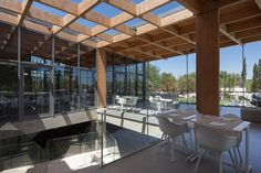 Exposed open structural framework create skylight over stair  Hotel Cafe in Portugal   Campos Costa Arquitectos