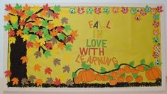 """""""Fall In Love With ______"""" is a popular title for an autumn bulletin board display. This teacher has added student photos inside the leaves (along the top and right) and her tree and pumpkin patch are very eye-catching."""
