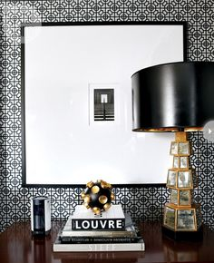 Black white and bronze. Love the geometric wallpaper pattern.