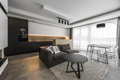 Black and White with Wooden Accents Apartment in Vilnius // 01