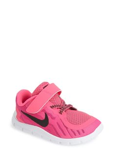 These vibrant pink Nike running shoes would look so adorable on the little one!