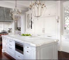 Built-in refrigerator - mirrored cabinets - chandeliers over island - white pain. Built-in refrigerator - mirrored cabinets - chandeliers over island - white painted cabinets - grey painted island - marble countertops . Paint Cabinets White, White Kitchen Cabinets, Kitchen Cabinet Design, Kitchen Interior, Modern French Kitchen, All White Kitchen, New Kitchen, Kitchen Ideas, Kitchen Sink