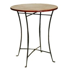 dd a touch of exotic, industrial-chic design to your décor with the Eyela Pub Table from C.G. Sparks. Handcrafted in India by skilled artisans, this eye-catching piece showcases iron-inspired metal framing and naturally-finished teak reclaimed from buildings in the Thar Desert.