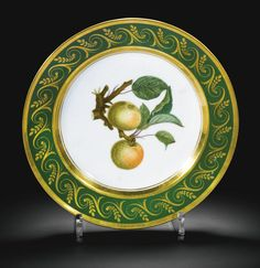 Italian, Doccia Ginori factory, circa 1820-1825 PLATE painted in the centre with two apples on a branch, inside a green border gilt with a band of foliate scrolls, gilt star mark porcelain 22cm., 8 3/4 in. diameter   See a Ginori Doccia board via Ann Wardley