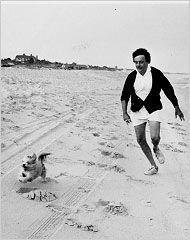 Kurt Vonnegut on the beach in East Hampton, N.Y., with his Lhasa apso, Pumpkin, on July 19, 1976. Photograph by his wife, Jill Krementz.