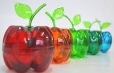 In Portuguese however the visual doesn't really need translation. How to make an apple container out of 2 plastic Bottles. Plastic Bottle Flowers, Plastic Bottle Crafts, Recycle Plastic Bottles, Soda Bottle Crafts, Soda Bottles, Recycled Bottles, Recycled Crafts, Diy And Crafts, Crafts For Kids