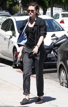 Dressed down: Kristen was kept to her classic style with loose fit trousers and a pair of ...