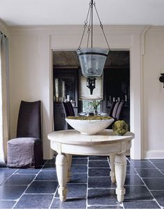 In this foyer of a Southern home, designed by Kay Douglass, the juxtaposition of an oversize honey-colored antique table and pale walls against dark bluestone floors has a quiet power. Design Entrée, Home Design, Design Ideas, Home Interior, Interior Design, Interior Ideas, Modern Interior, Belgian Style, French Style